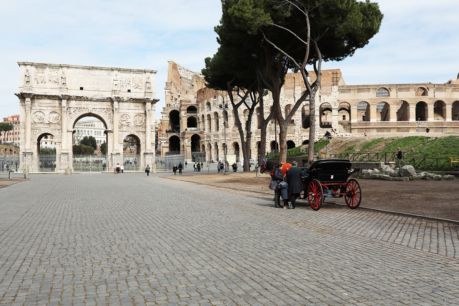 The square in front of the Colosseum, which is usually crowded with hundreds of tourist stands almost empty on March 5, 2020 in Rome, Italy