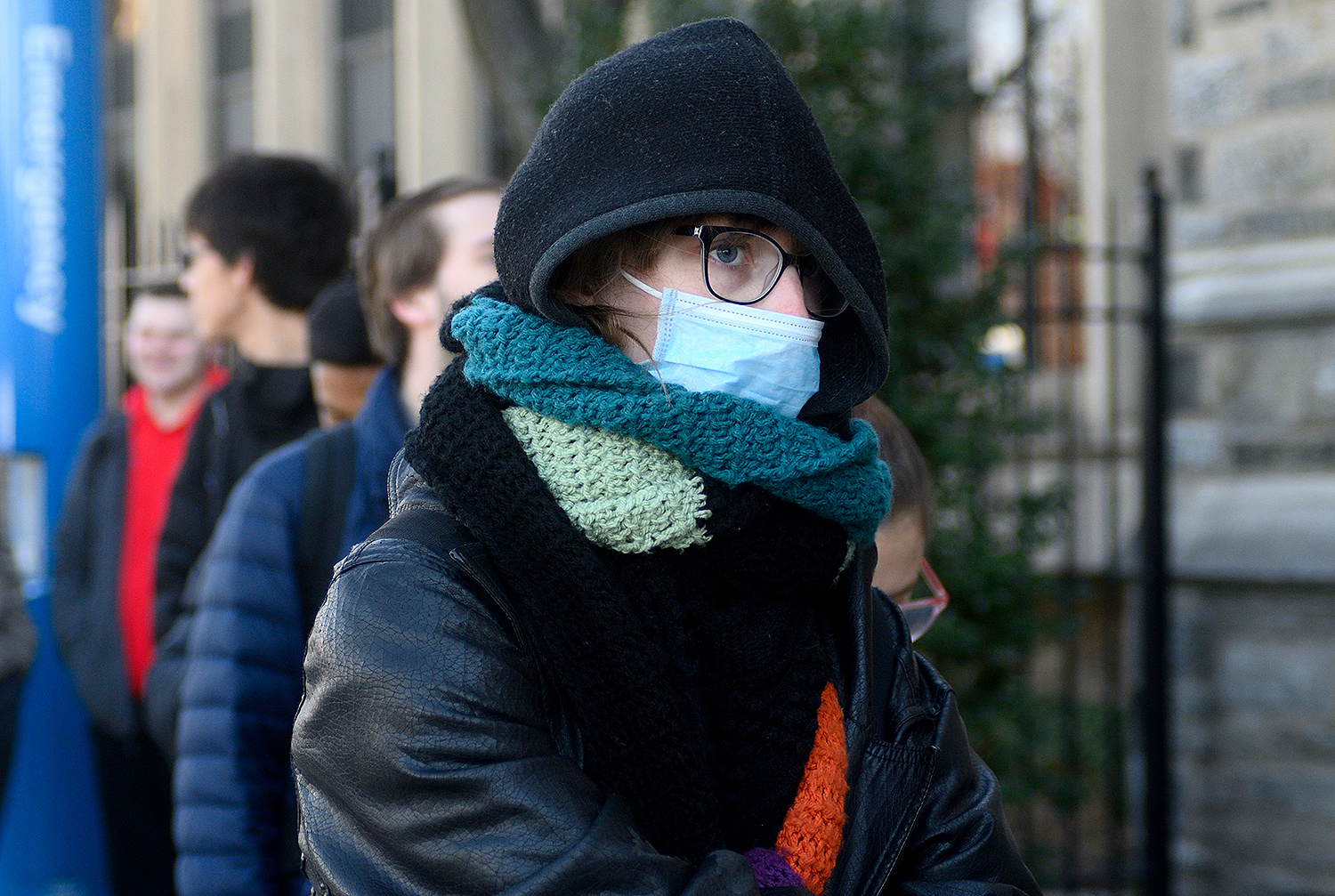 A female is seen wearing face mask