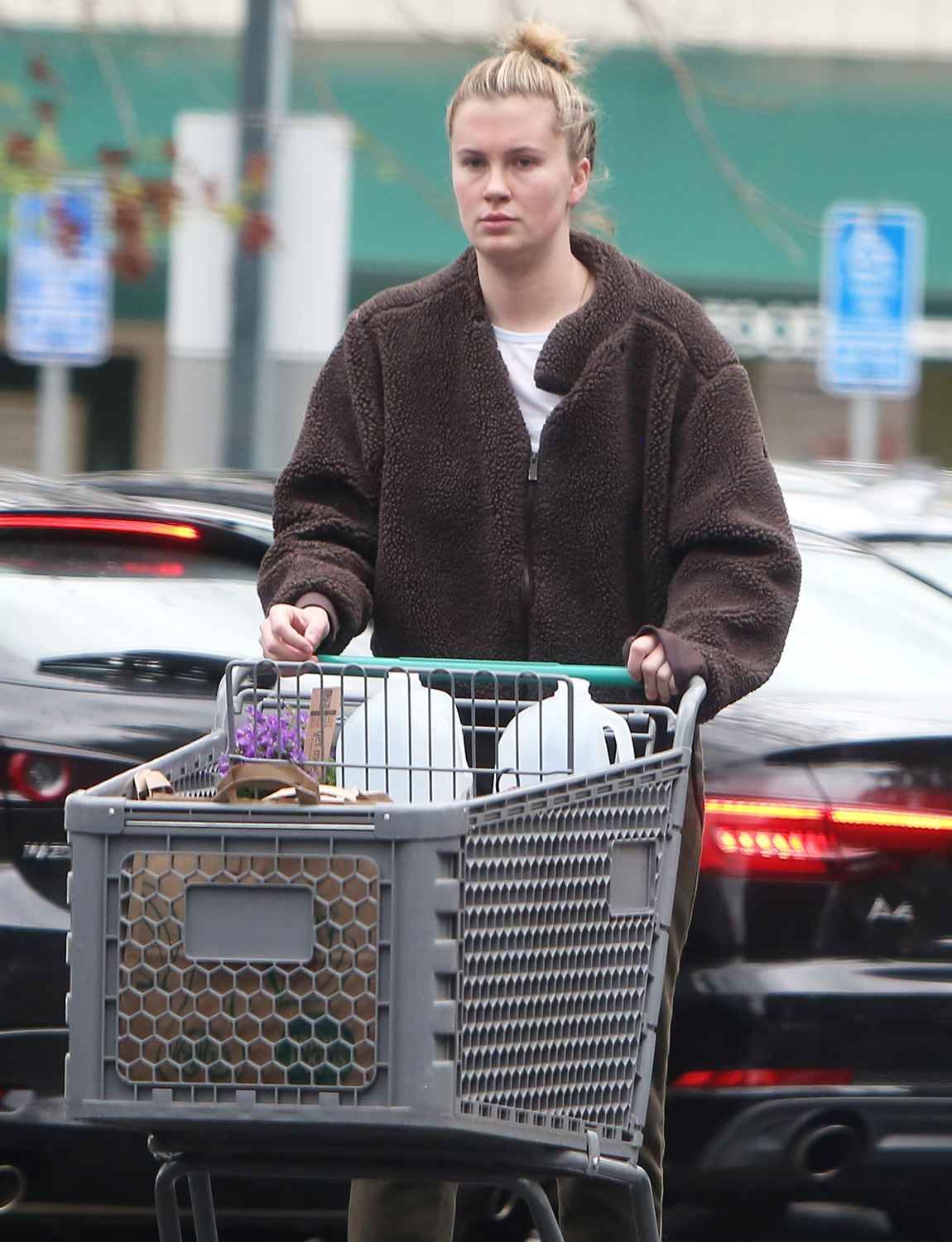 Ireland Baldwin stocks up on groceries at Whole Foods during a break in the rainy weather