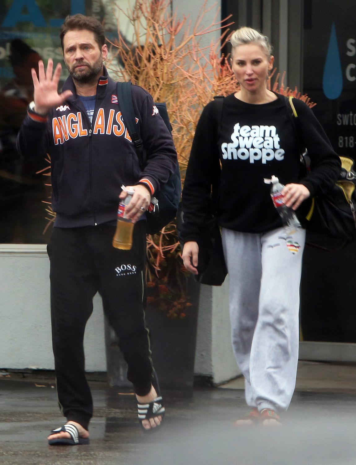 LA Rain ain't going to stop Jason Priestley and his Wife/Trainer Naomi Lowde-Priestley from hitting the gym for an early morning workout in Los Angeles
