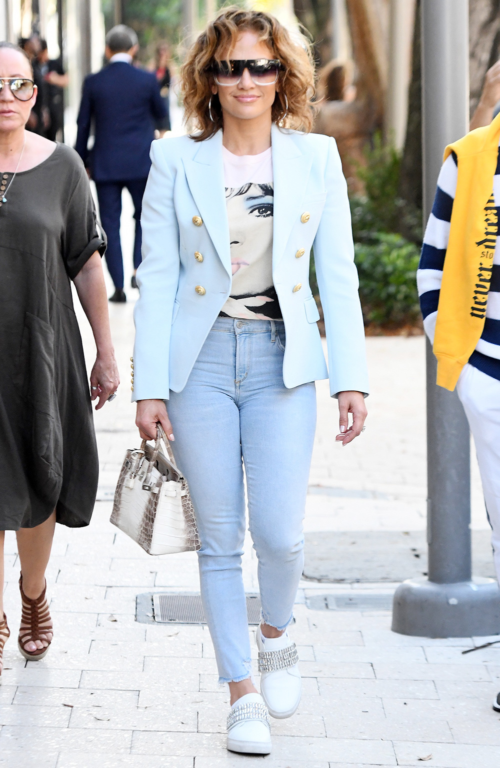 Jennifer Lopez shows off her natural wavy hair as she hits the shops of the Design District in Miami, Florida