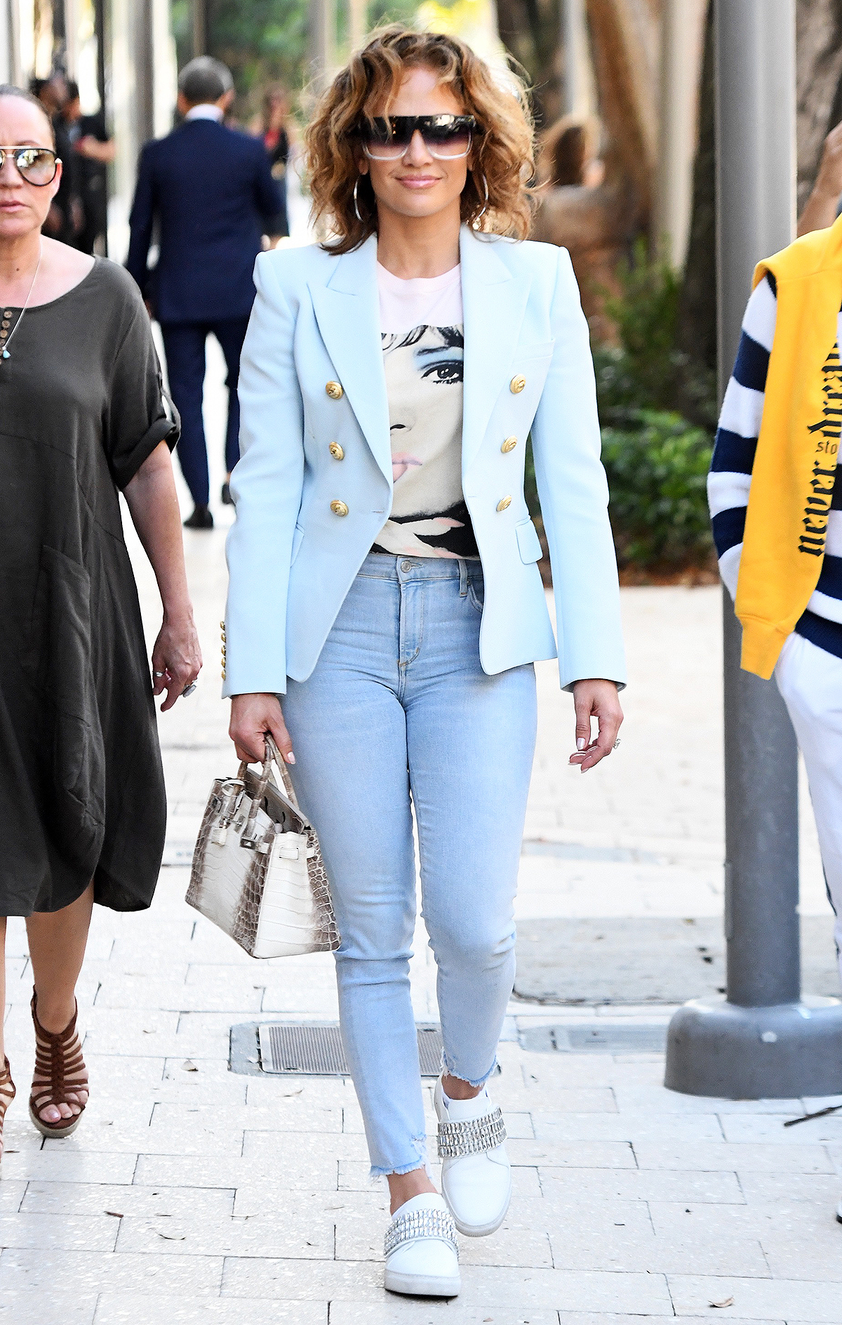 Jennifer Lopez shows off her natural wavy hair as she hits the shops of the Design District in Miami, Florida. Jennifer shops at Dior, Yves Saint Laurent, Hermes and Fendi. 05 Mar 2020