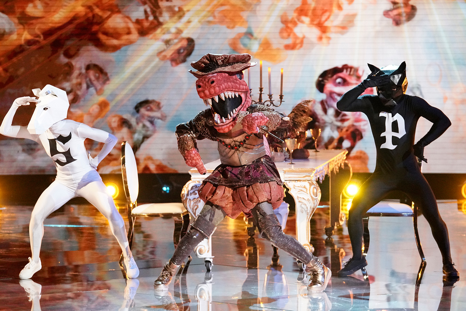 "The Masked Singer: T-Rex in the ""It Never Hurts to Mask: Group C Playoffs"" episode of THE MASKED SINGER airing Wednesday, March 18"