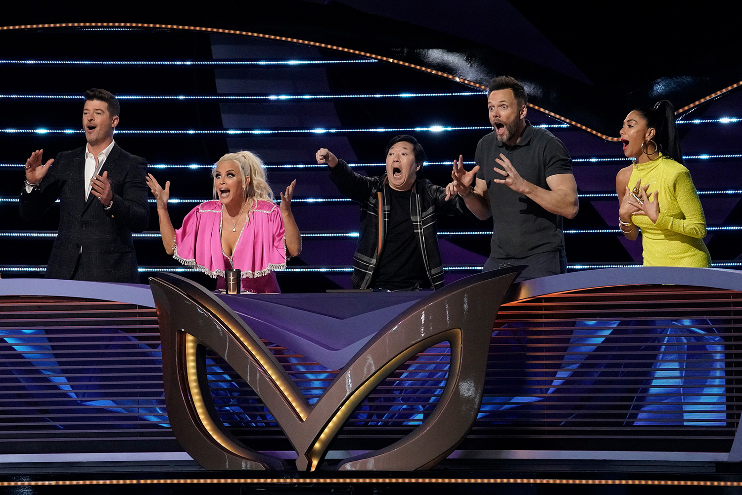 "The Masked Singer: L-R: Robin Thicke, Jenny McCarthy, Ken Jeong, guest panelist Joel McHale and Nicole Scherzinger in the ""It Never Hurts to Mask: Group C Playoffs"" episode of THE MASKED SINGER airing Wednesday, March 18"