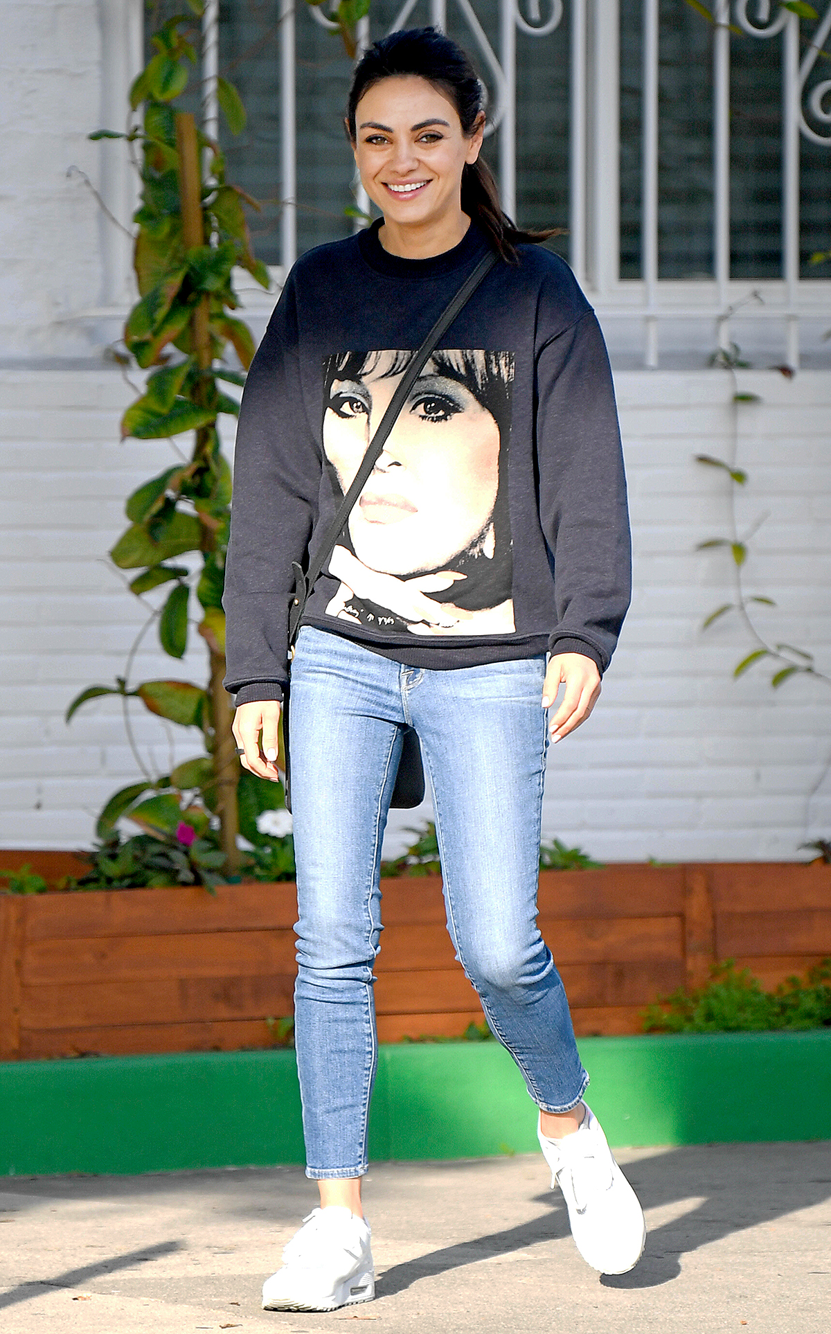 ila Kunis is all smiles as she steps out in Los Angeles.