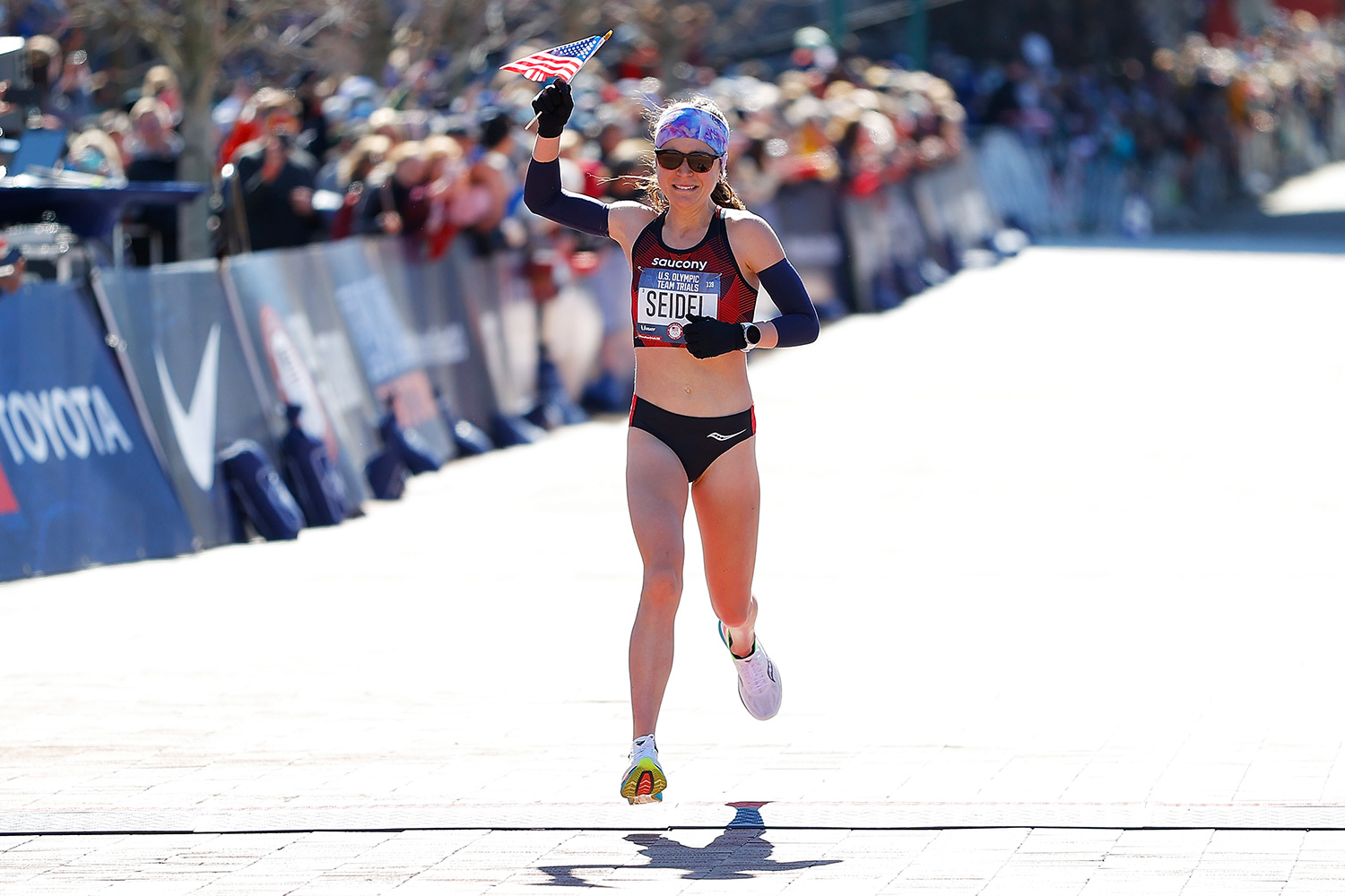 Molly Seidel reacts as she crosses the finish line in second play during the Women's U.S. Olympic marathon team trials on February 29, 2020 in Atlanta, Georgia