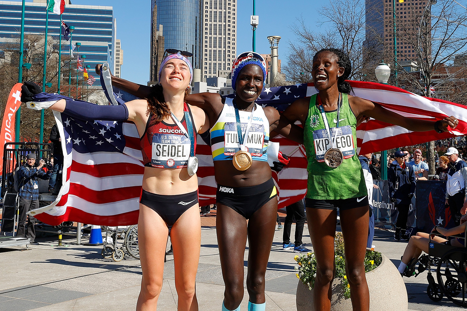Molly Seidel, Aliphine Tuliamuk, and Sally Kipyego pose after finishing in the top three of the Women's U.S. Olympic marathon team trials on February 29, 2020 in Atlanta, Georgia