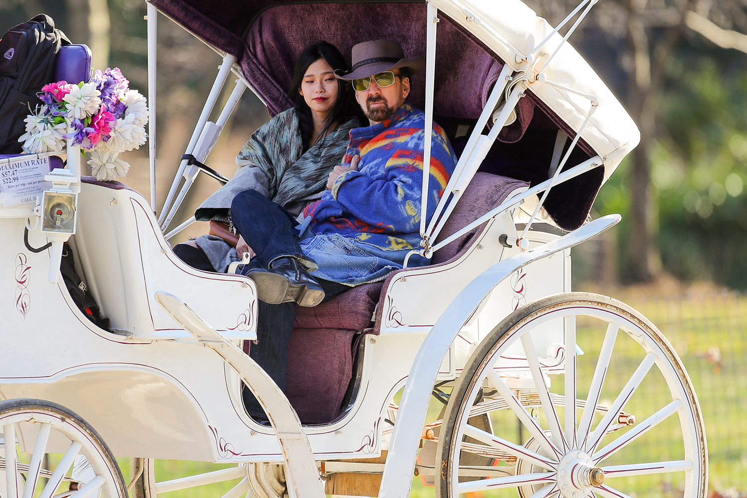 Nicolas Cage takes New Girlfriend Riko Shibata for a horse carriage ride in Central Park in New York City