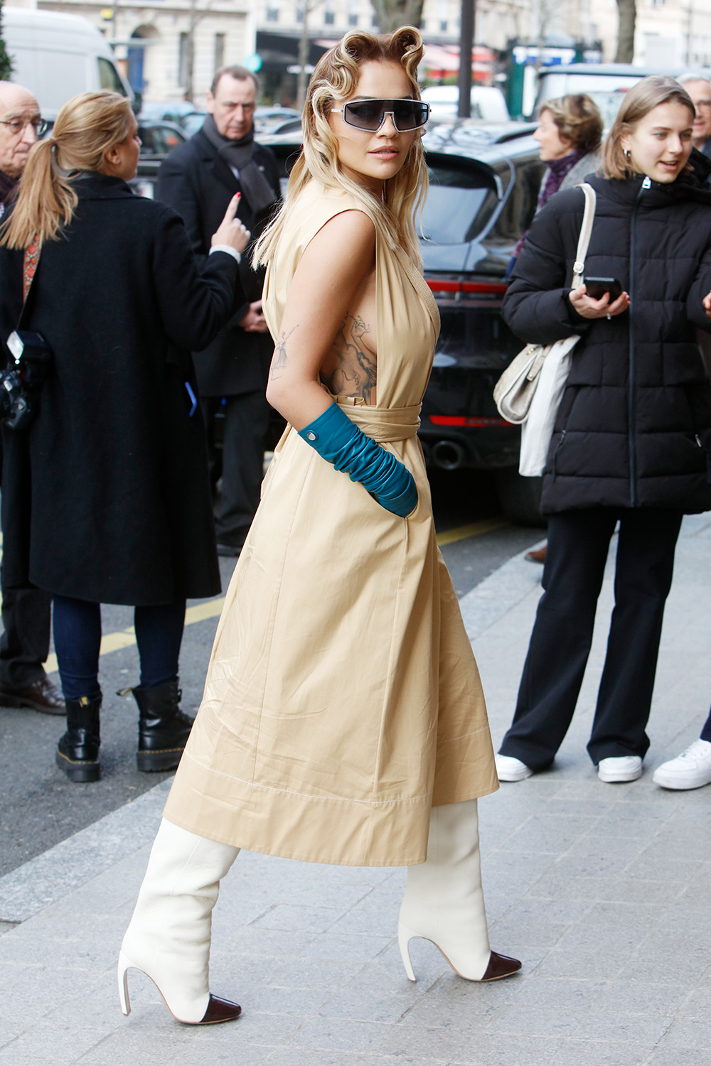 Rita Ora flashes side boob as she arrives in a stunning gold outfit during Paris Fashion Week. Paris. Paris, France - Tuesday March 3, 2020. USA