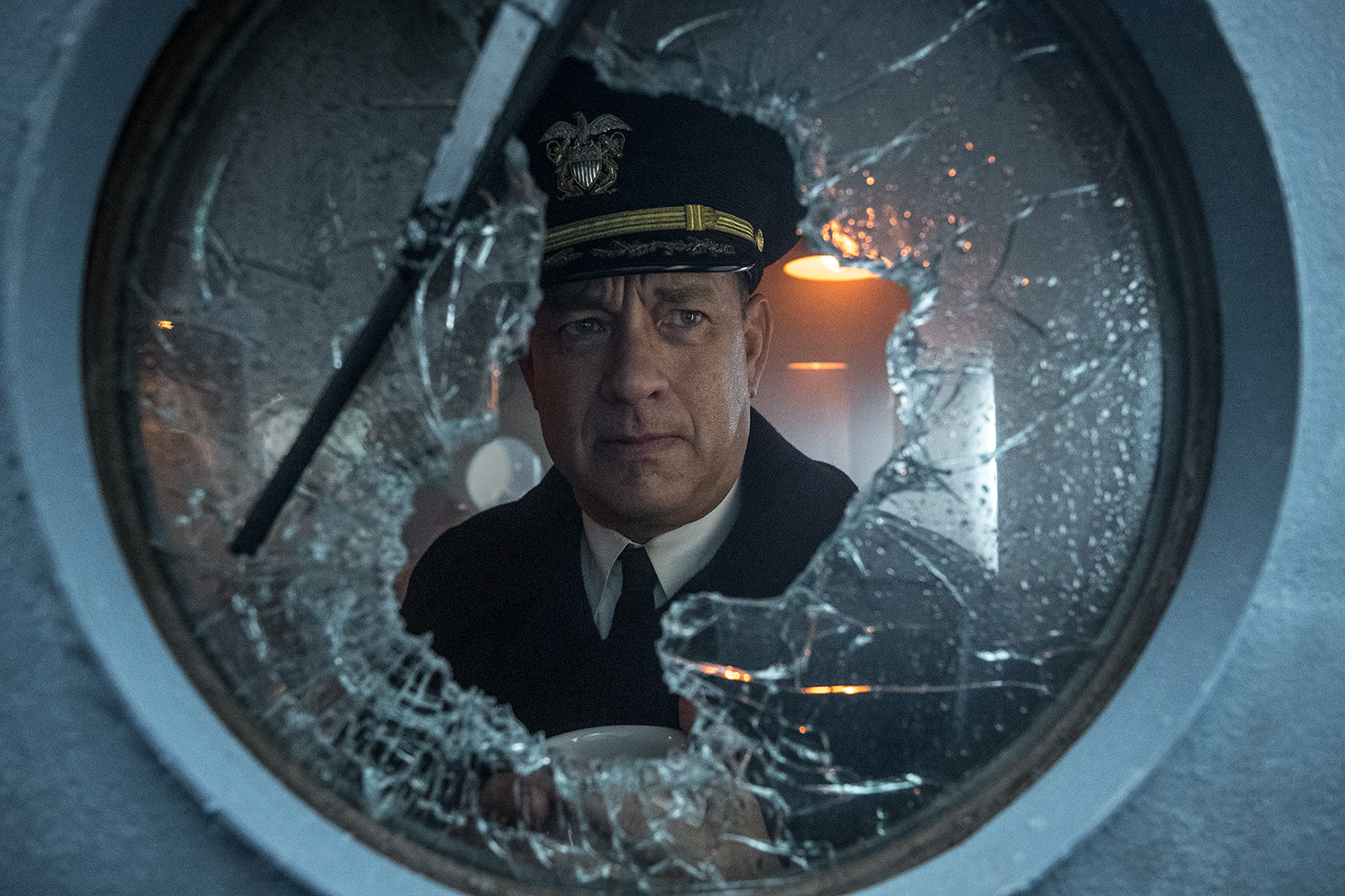 Capt Krause (TOM HANKS) peers out the broken pilot house window in TriStar Pictures' GREYHOUND.