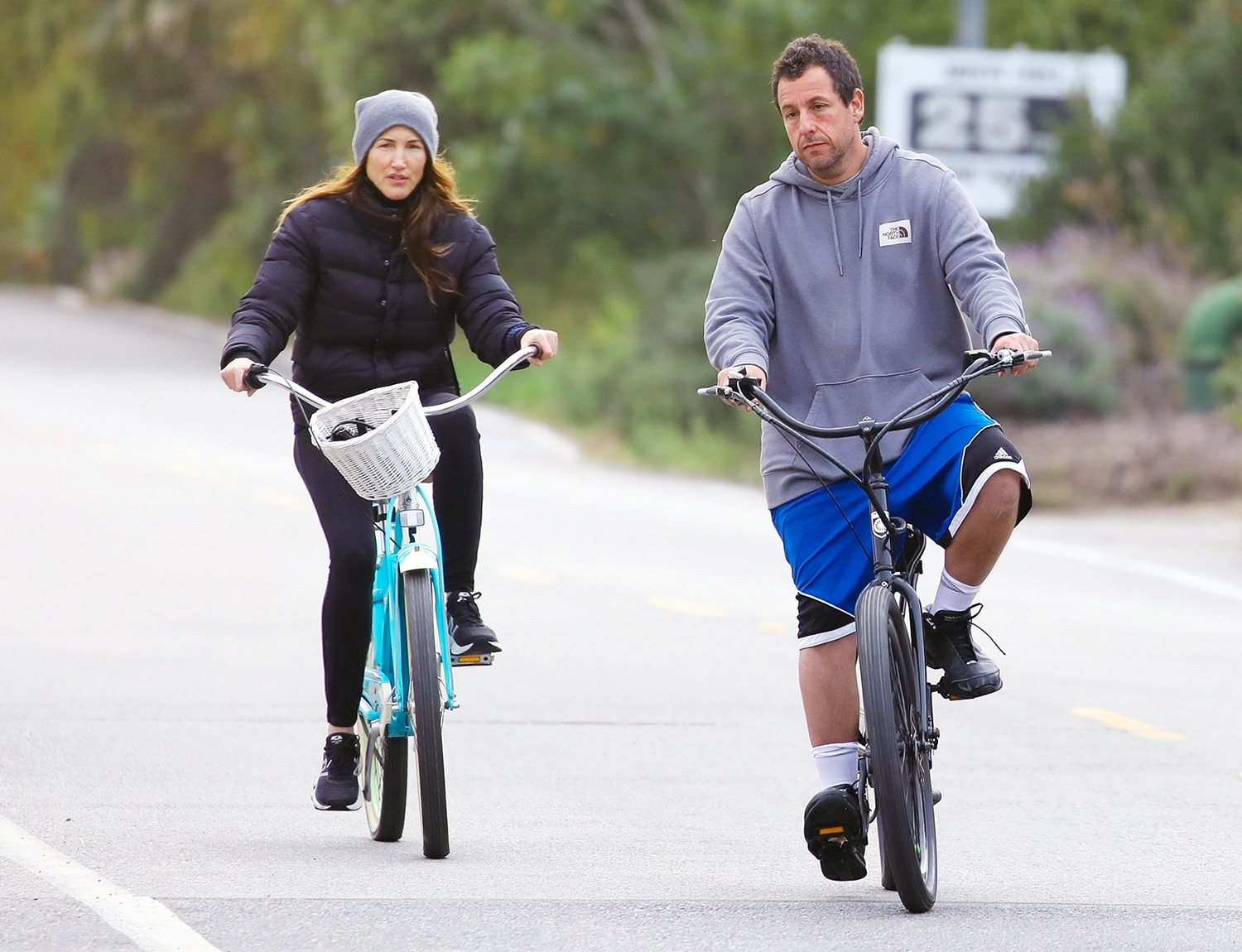 Adam Sandler bikes with his wife Jackie by the beach!