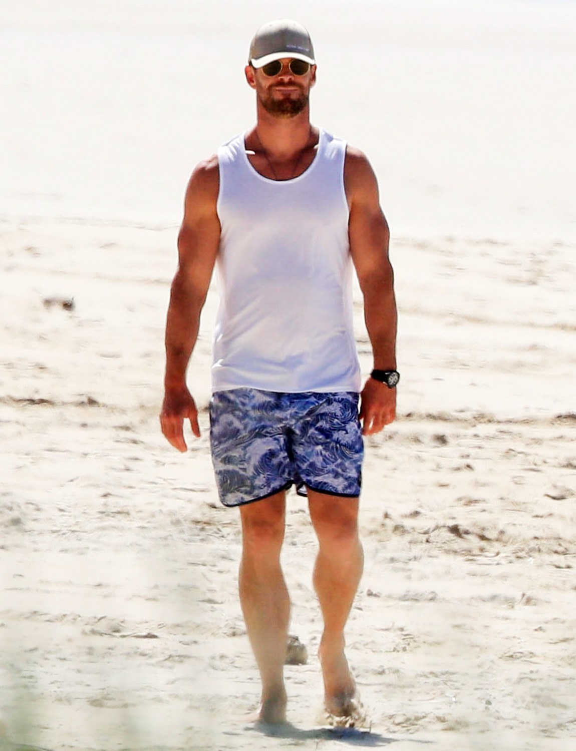 Chris Hemsworth and wife Elsa Pataky enjoy some exercise at a quiet beach in Byron Bay, Australia