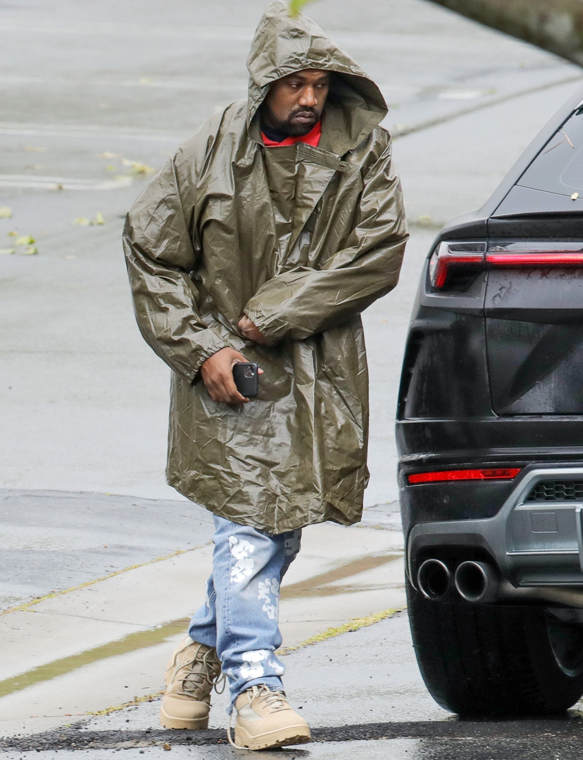 Kanye West wears Rain Poncho to his Office