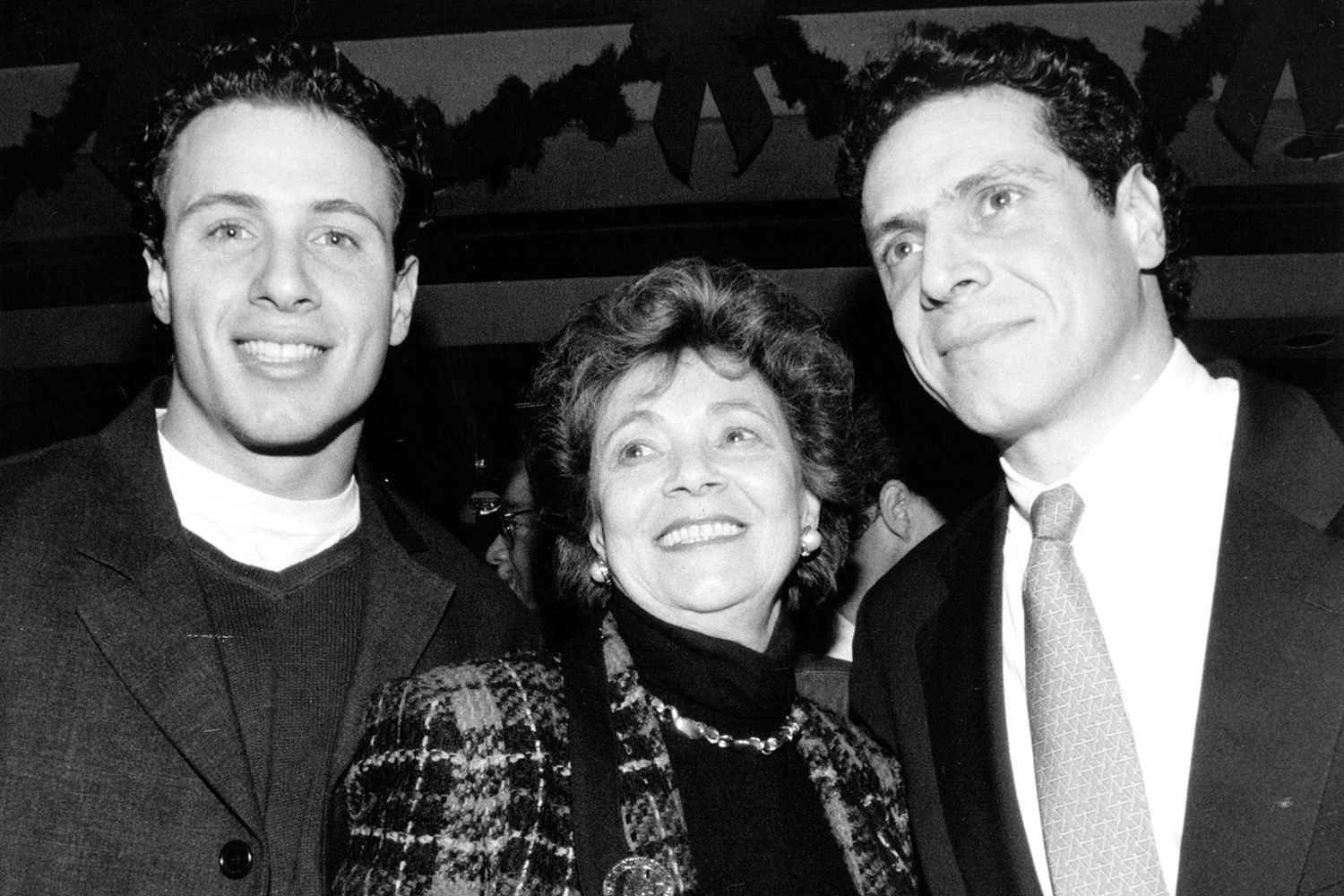 New York's First Lady Matilda Cuomo with her sons Chris Cuomo, left, and Andrew Cuomo during Andrew's birthday party in New York City. December 19, 1994.