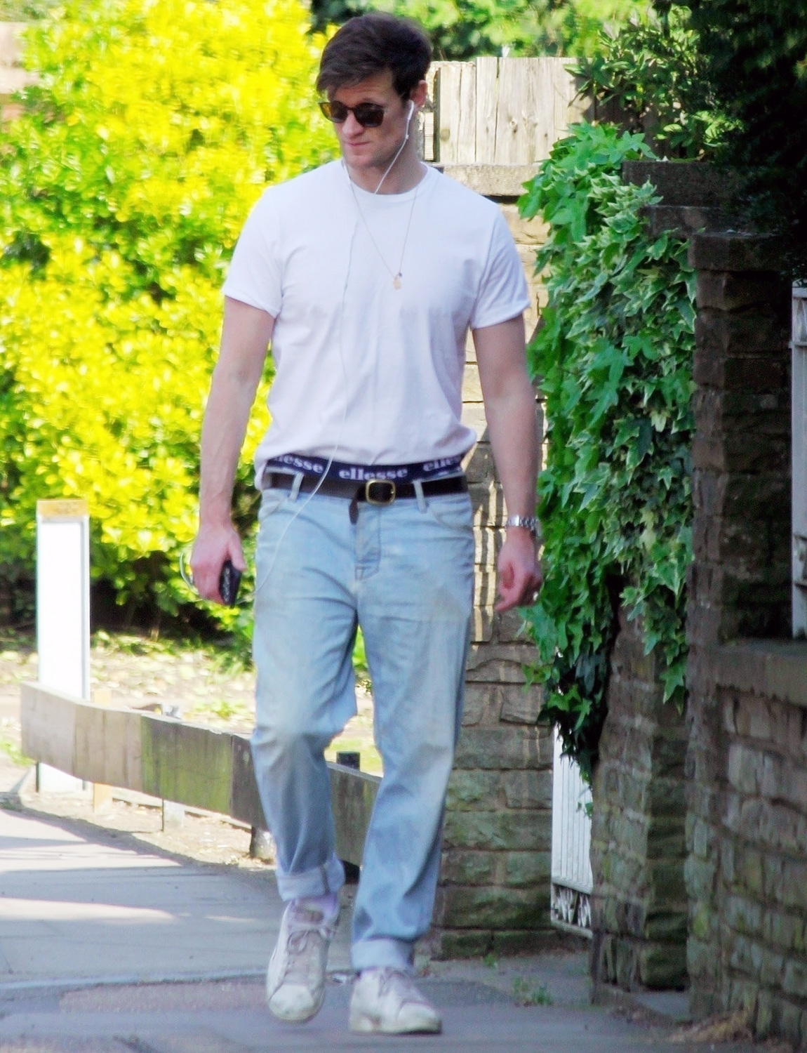 Matt Smith takes a solo stroll while showing us his underwear