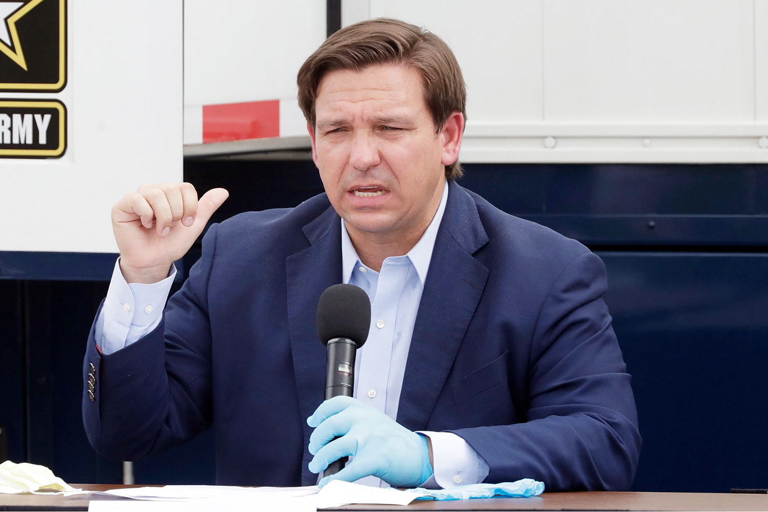 Florida Gov. Ron DeSantis, gestures as he speaks during a news conference in front of a U.S. Army Corps of Engineers mobile command center at the Miami Beach Convention Center, in Miami Beach, Fla. The Corps of Engineers will transform the newly renovated facility into a hospital by April 27, news outlets reported Tuesday Virus Outbreak Field Hospital, Miami Beach, United States - 08 Apr 2020
