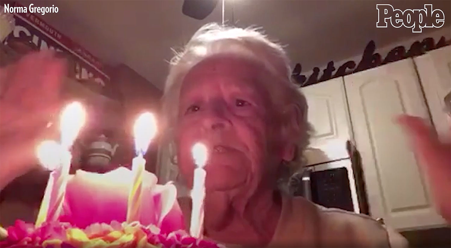 woman sings happy birthday to herself