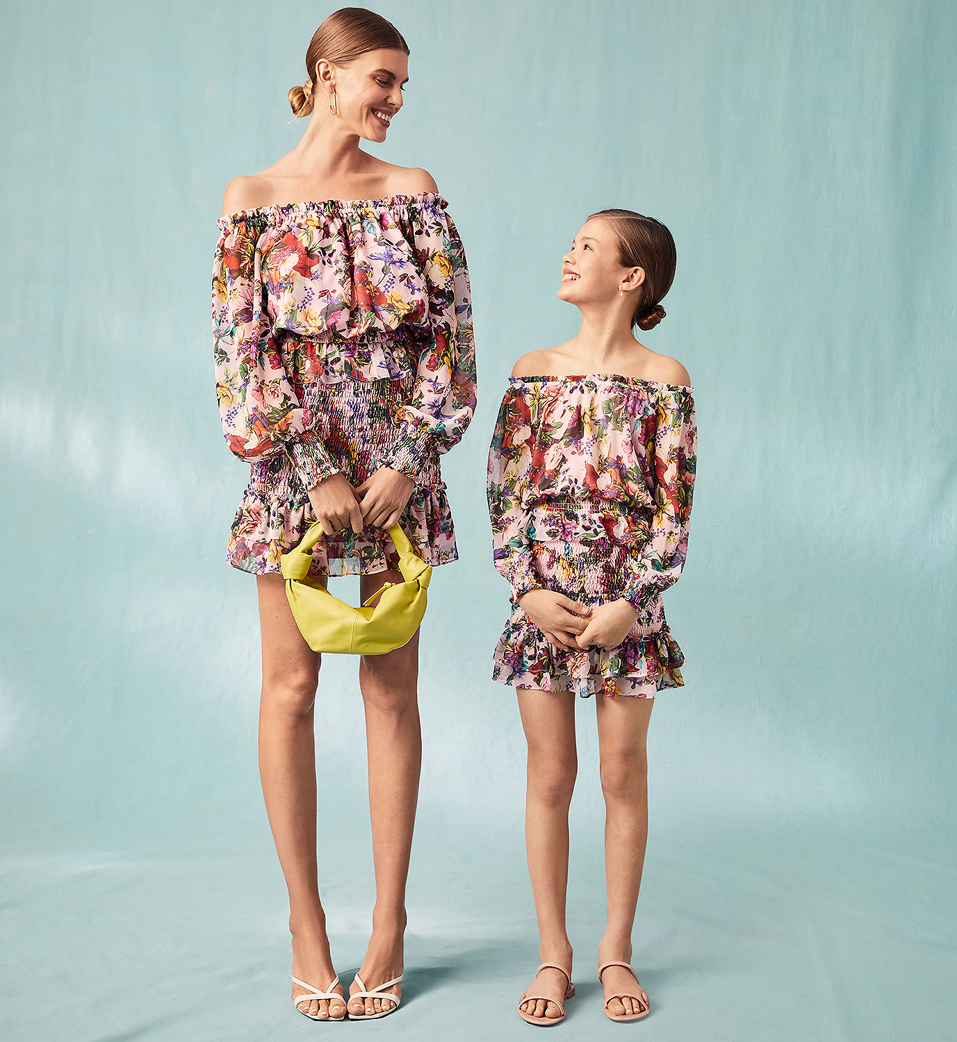 """Mary Katrantzou, widely considered """"the Queen of Print,"""" is bringing her signature aesthetic to Bloomingdales through a collaboration with AQUA, one of the department store's premiere private labels. The limited-edition 18-piece Aqua x Mary Katrantzou capsule collection features dresses and separates ranging from $78 to $378 in four new prints: butterflies, leopards, rainbow parrots and pink florals.                             """"I am excited for the launch of our capsule collection forAQUAthat was designed with the intention to create a joyful and feel-good collection that will appeal to women of all ages,"""" Katrantzou said in a statement. """"For the first time we also had the opportunity to delve into girl's sizing, which was a great creative challenge.The idea was to bring nature's forms into the prints: from monarch butterflies to punchy florals, and from leopard prints to tropical bird prints, giving the wearer the option to mix and match the styles and patterns.""""                             Buy It! AQUA x Mary Katrantzou Parrot Print Off The Shoulder Romper, $118; bloomingdales.com"""
