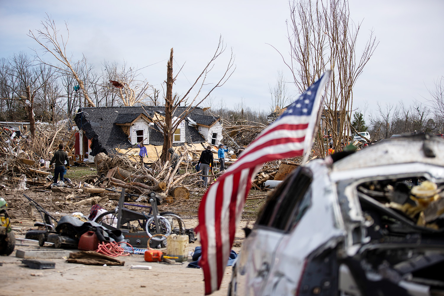 Volunteers work to clean up tornado-damaged areas on March 4, 2020 in Cookeville, Tennessee