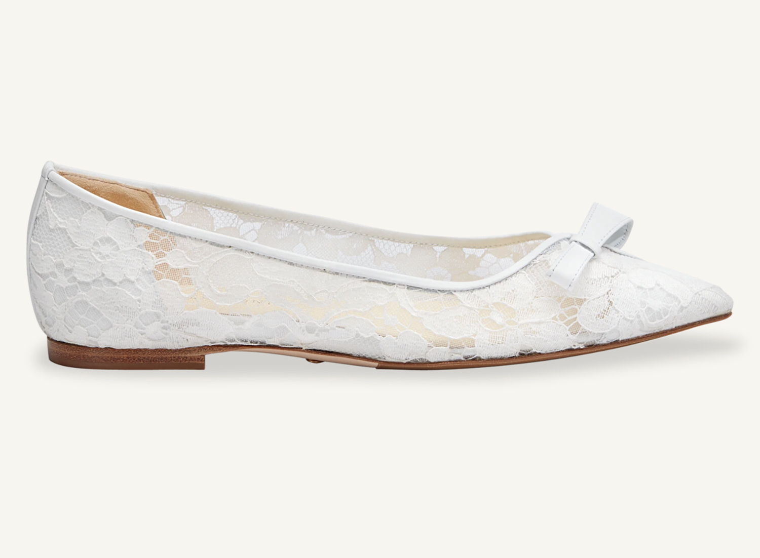 The New York-based shoe label launched an elegant wedding version of its best-selling (and Meghan Markle-approved!) Natalie Flat. Now available in white lace, the ultra-comfortable pointed style, which features extra padding and a wide toe box, is perfect for large celebrations, intimate ceremonies, courthouse weddings, bridal showers and more!                             Buy It! Natalie Flat in White Lace, $435; sarahflint.com