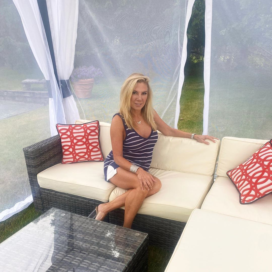 """The Real Housewives of New York star lounged in her """"new favorite backyard oasis,"""" complete with red patterned pillows, white cushions and mosquito netting."""