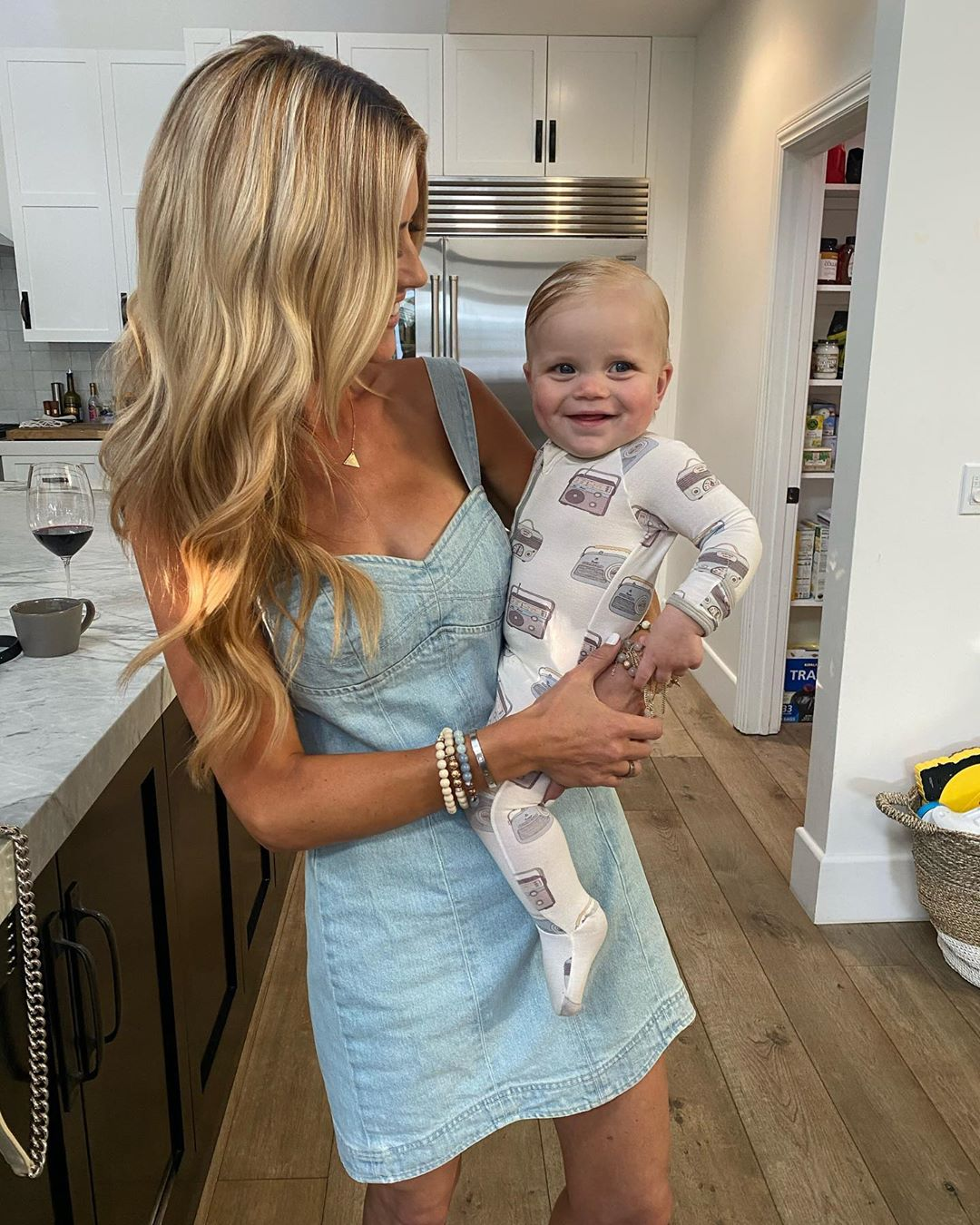 """Look at that smile! The Christina on the Coast star cozied up to her son, Hudson London, 10 months, whom she shares with husband Ant Anstead.                             """"Love his fresh out of the bath comb over 😍💙,"""" she wrote."""
