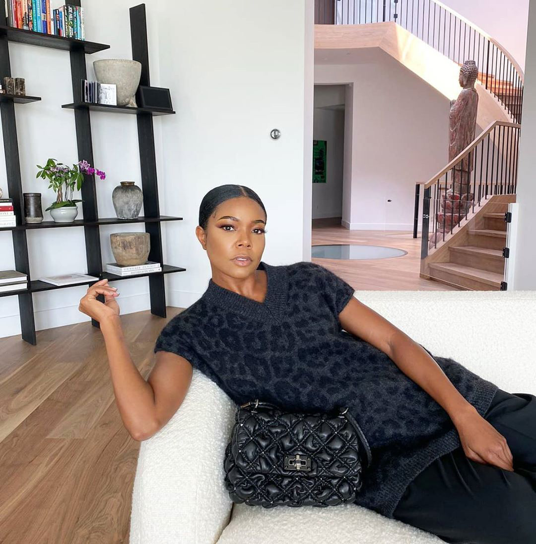 """""""All dressed up to sit on the sofa,"""" wrote the L.A.'s Finest star, sharing a fashionable snap from her home in California, where she lives with her husband, retired NBA star Dwyane Wade, and their adorable daughter, Kaavia James, 1."""