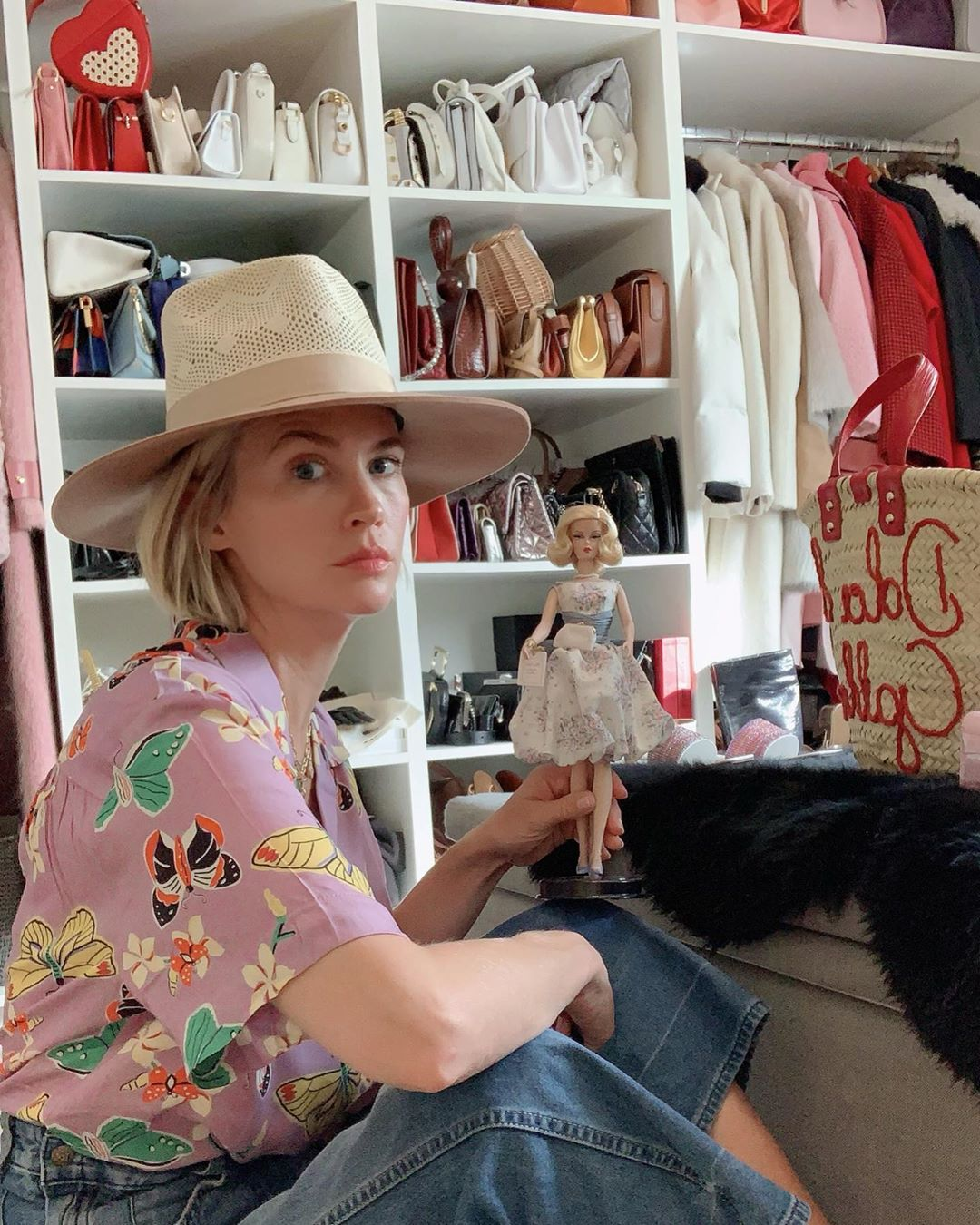 """""""Just playing with my Barbie, dreaming about wearing uncomfortable shoes and clothes again..."""" the Mad Men actress joked, sharing a photo of herself hanging out in her walk-in closet amid the coronavirus pandemic.                             She also added a funny hashtag: """"#someoneneedsacreativeoutletasap."""""""