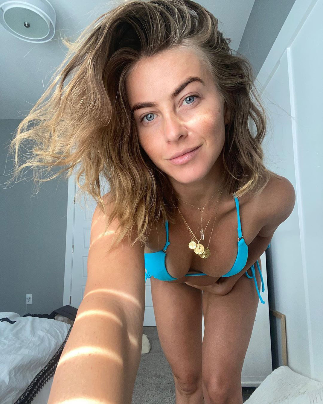 """""""Different kind of Sunday Blues,"""" wrote the Dancing With the Stars alum, taking a bedroom selfie in a turquoise bikini."""