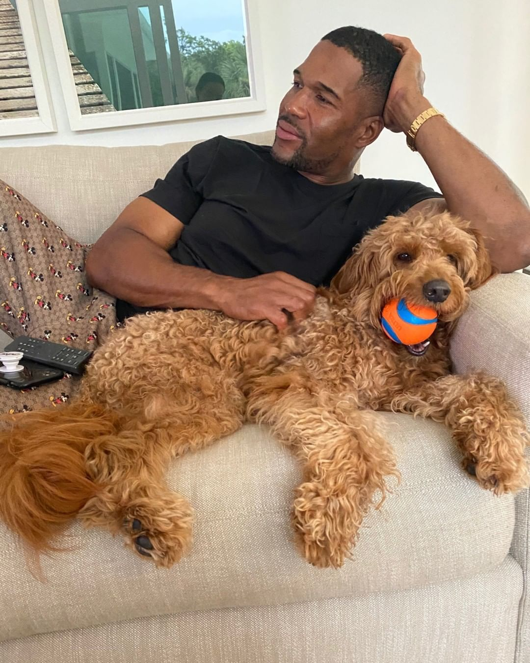 """The Good Morning America host's sweet pup, Enzo, is a cuddler! """"Enzo wouldn't let me relax alone. LOL!"""" Strahan wrote, adding, """"#Enzoistheboss."""""""