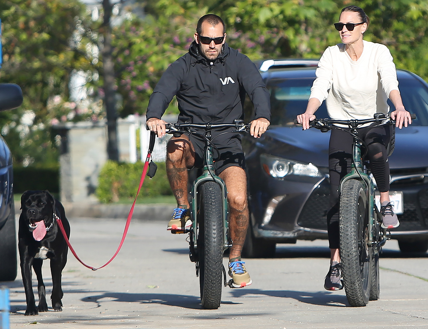 Robin Wright and husband Clement Giraudet riding their bikes during social isolation in Los Angeles