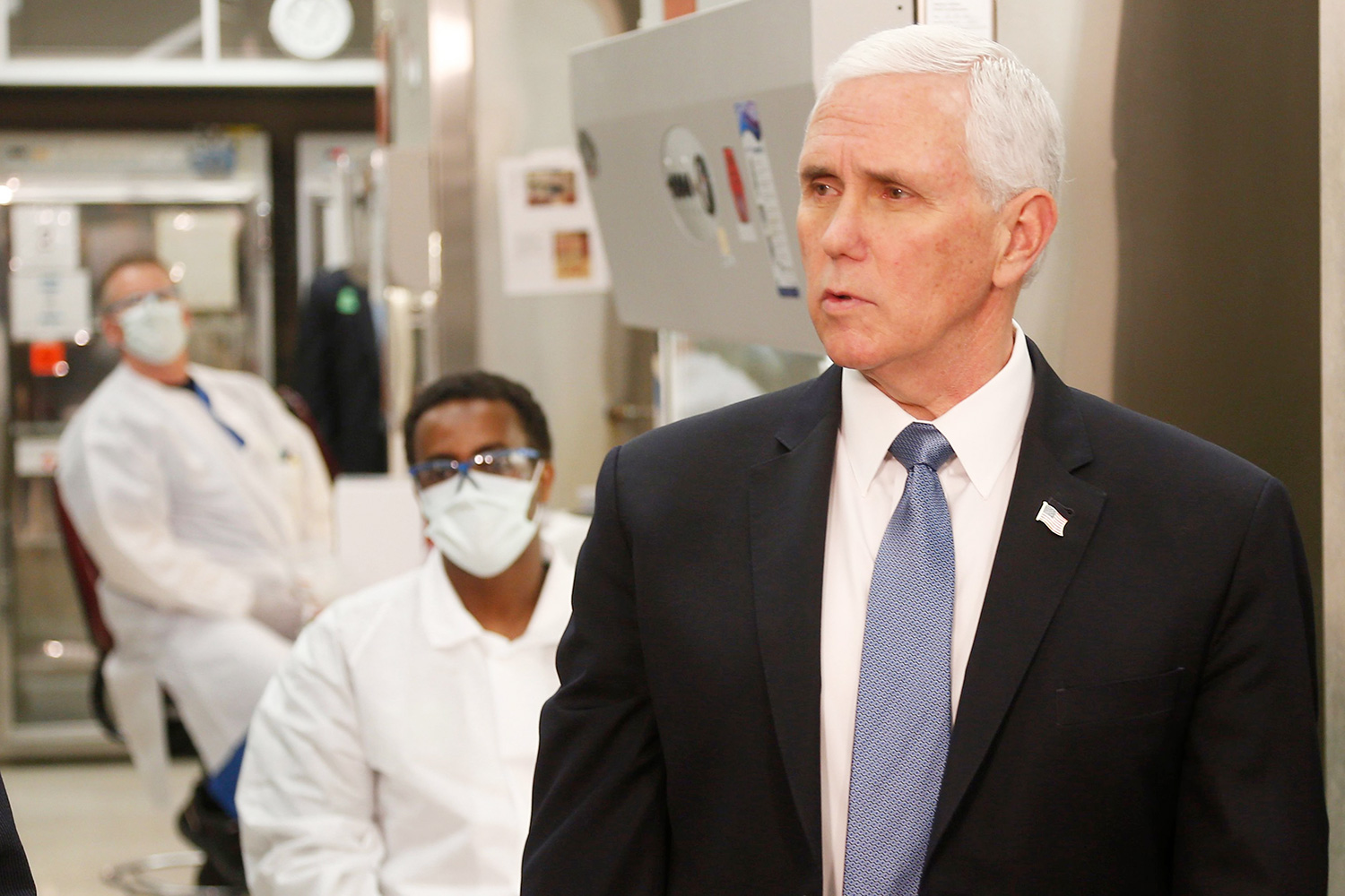 Vice President Mike Pence, left, visits the Mayo Clinic, in Rochester, Minn
