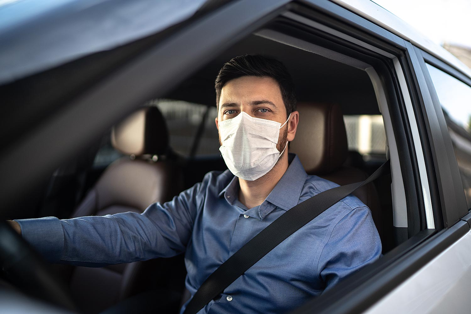 person driving wearing mask