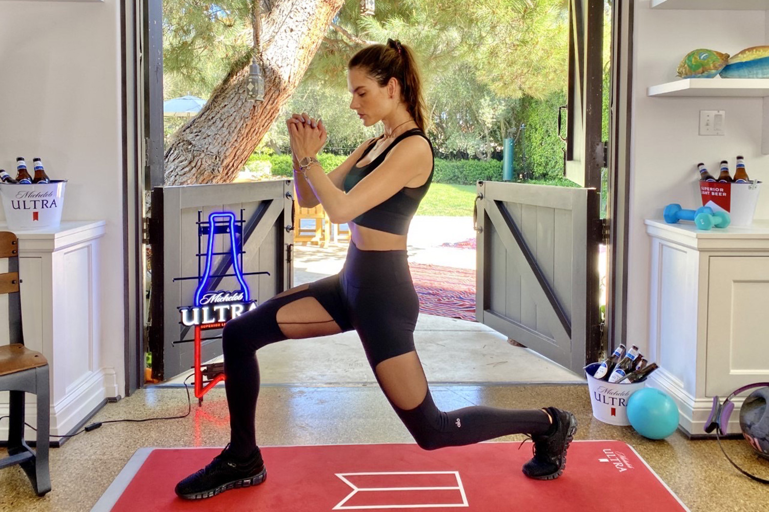 Alessandra Ambrósio works out from home while supporting local gym owners and trainers during Michelob ULTRA's livestream workout series