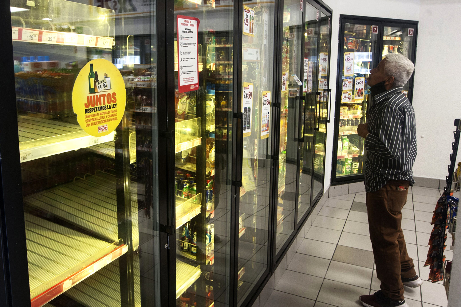 Empty beer refrigerators at a store in Nuevo Leon, Mexico, this month. Shuttered breweries have led to widespread beer shortages