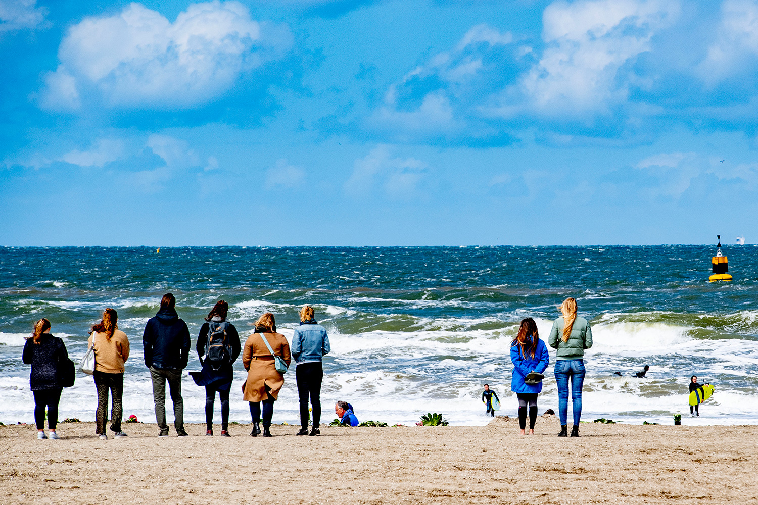 """Five surfers died after getting into difficulty in """"avalanche-like"""" sea foam caused by stormy conditions off a popular Dutch beach, police and witnesses said May 12,"""