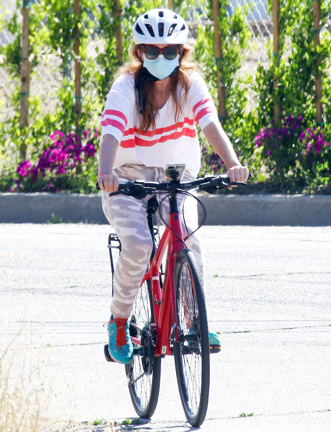 Isla Fisher is seen riding a bicycle on May 26, 2020 in Los Angeles, California