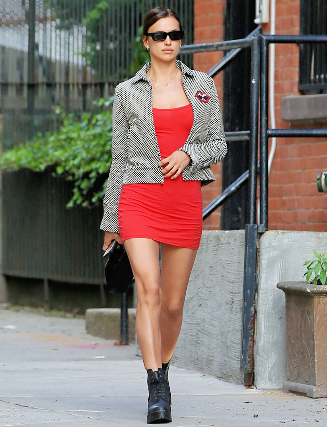 Model Irina Shayk Is Seen In A Short Red Dress, Chrome Hearts Short-Waisted Jacket