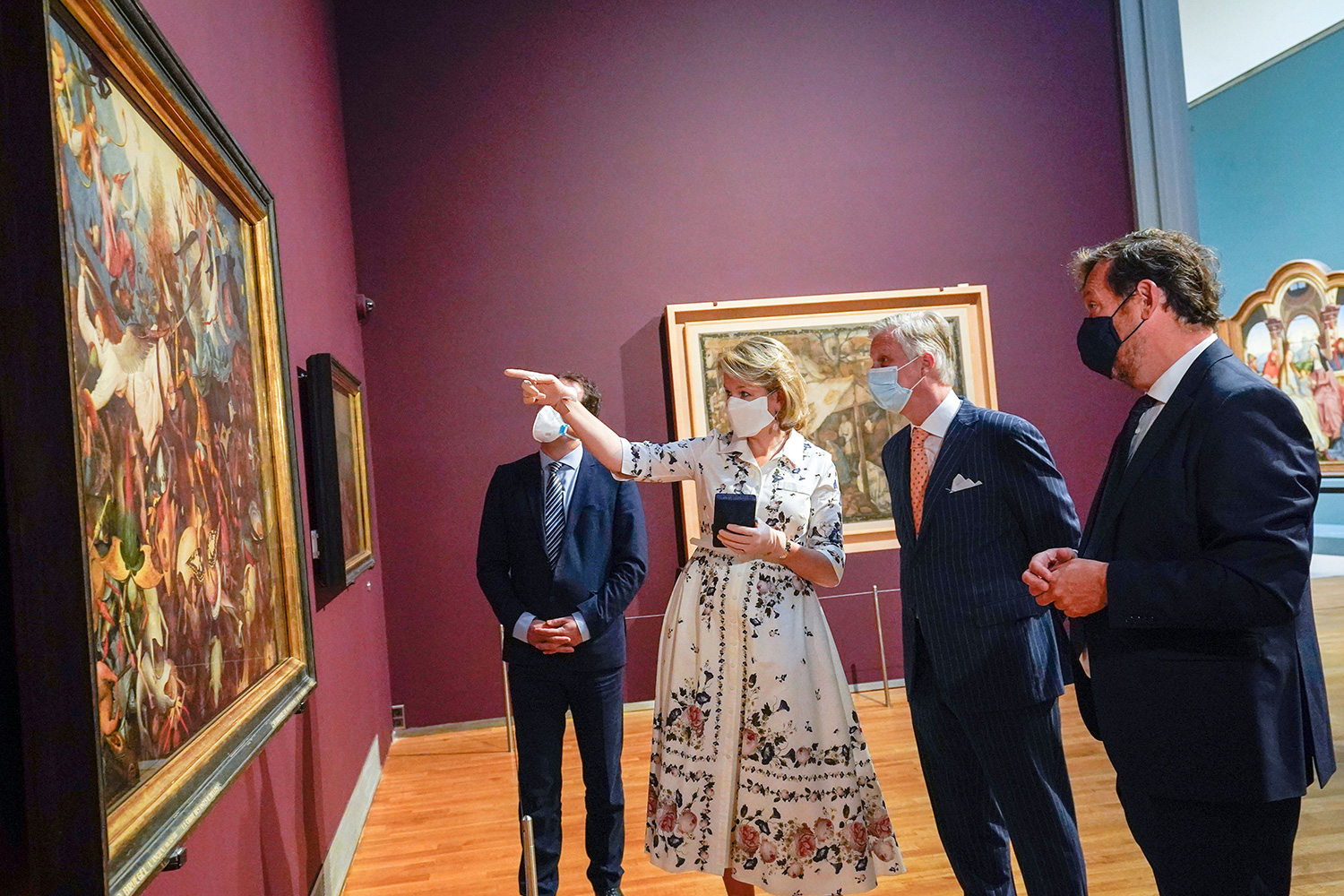 Belgium's King Philippe, second right, and Belgium's Queen Mathilde, second left, wear a face mask to prevent the spread of coronavirus, as they visit the Royal Museum of Fine Arts in Brussels
