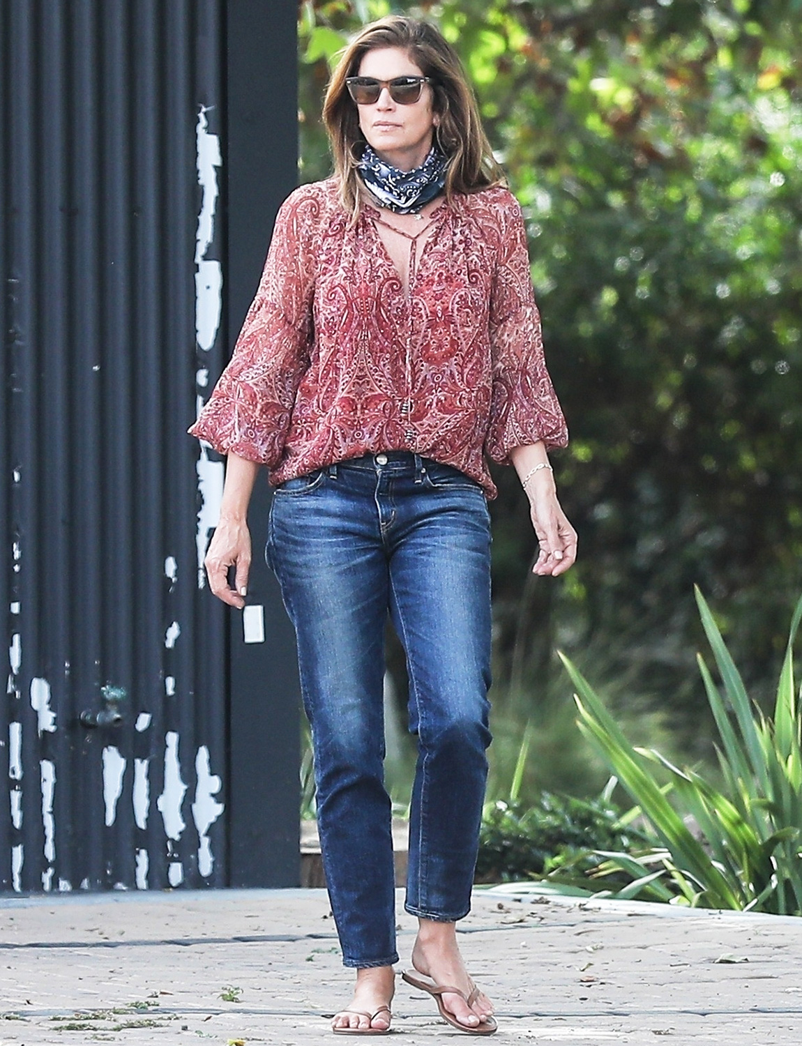 Cindy Crawford looks flawless as she picks up food with hubby Rande Gerber