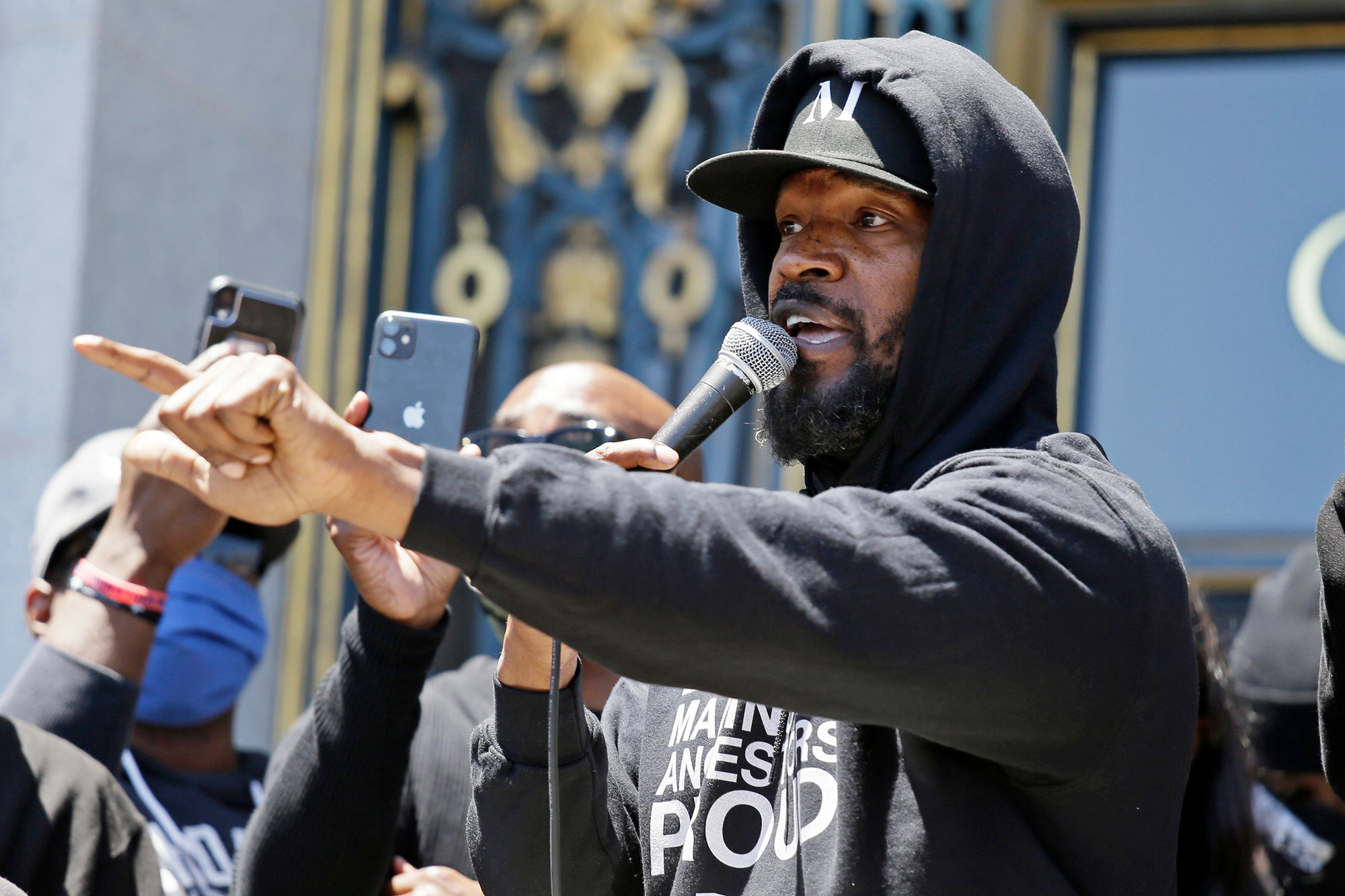 "Jamie Foxx speaks to a large crowd during a ""kneel-in"" to protest police racism on the steps of City Hall, in San Francisco America Protests"