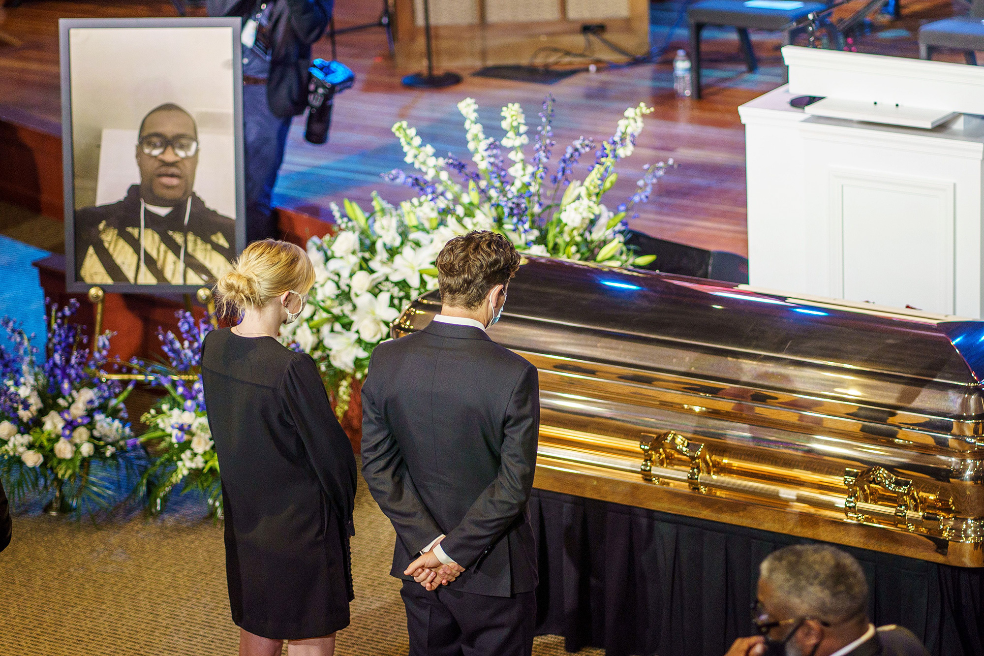 Minneapolis Mayor Jacob Frey(C) shows his respect to the remains of George Floyd awaiting a memorial service in his honor on June 4, 2020