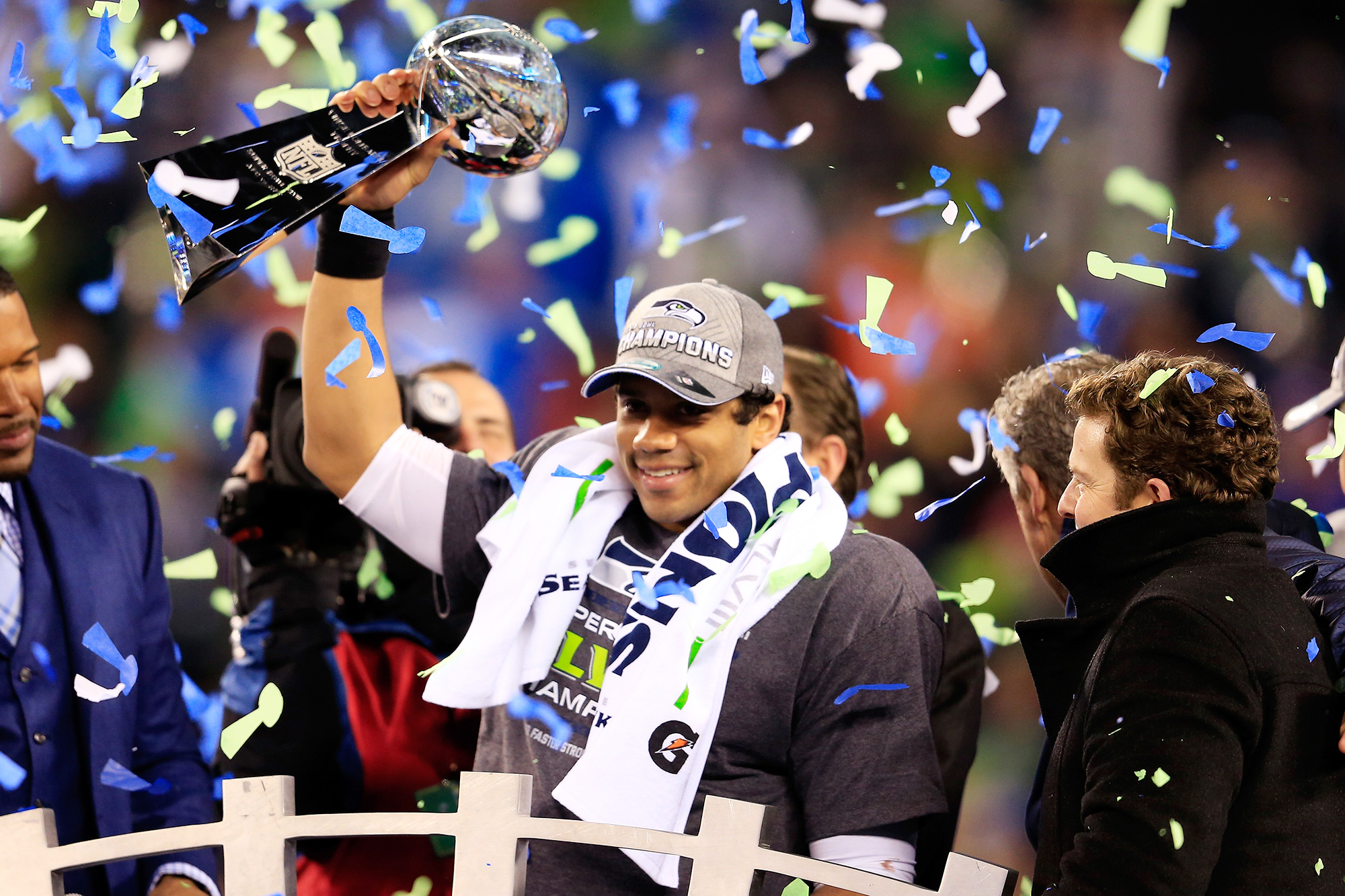 Russell Wilson #3 of the Seattle Seahawks celebrates with the Vince Lombardi trophy after defeating the Denver Broncos 43-8 in Super Bowl XLVIII at MetLife Stadium on February 2, 2014 in East Rutherford