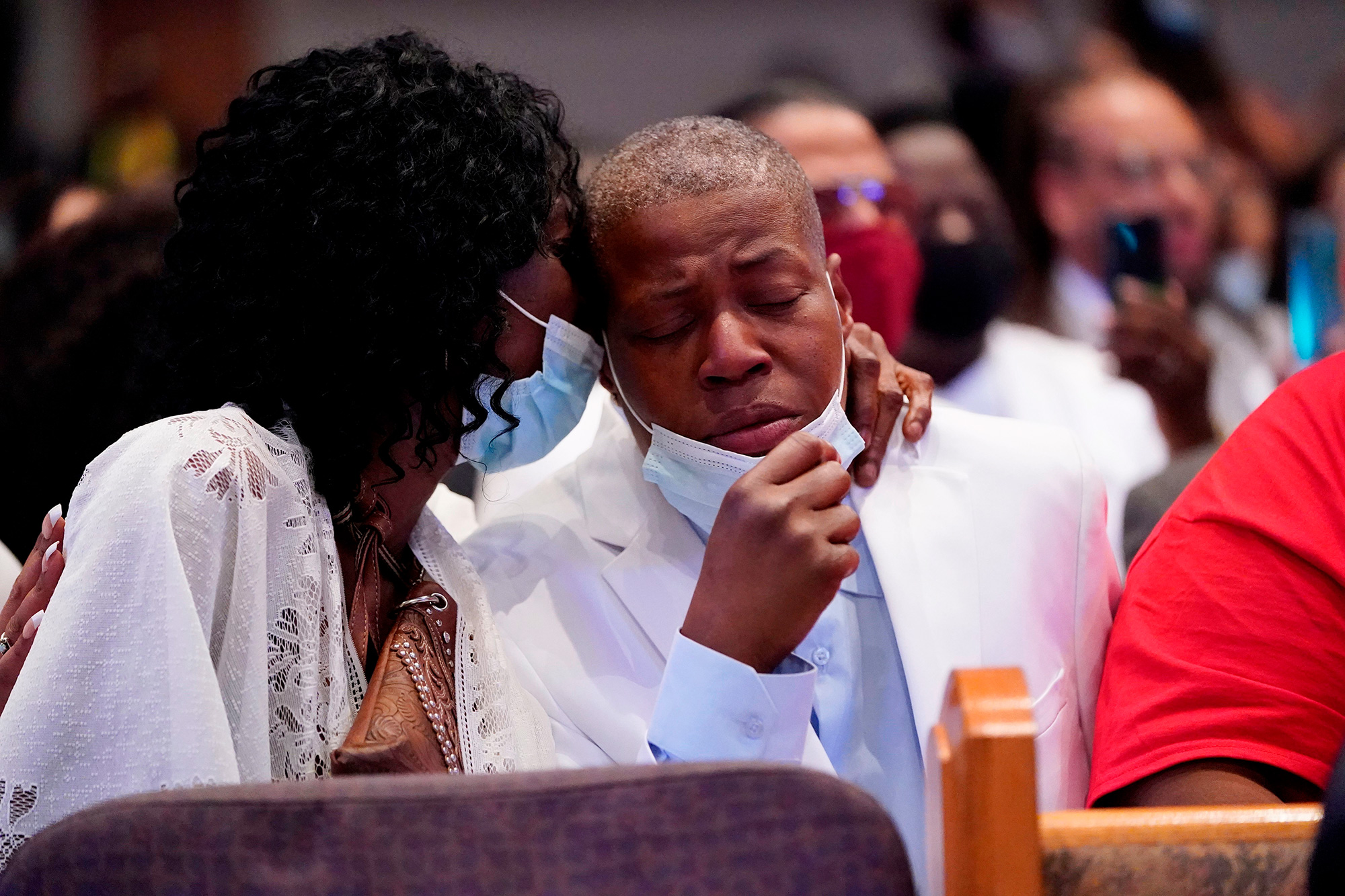 Sisters of George Floyd Zsa Zsa Floyd, embraces her sister LaTonya Floyd during a funeral service for George Floyd at The Fountain of Praise church Tuesday, June 9, 2020, in Houston