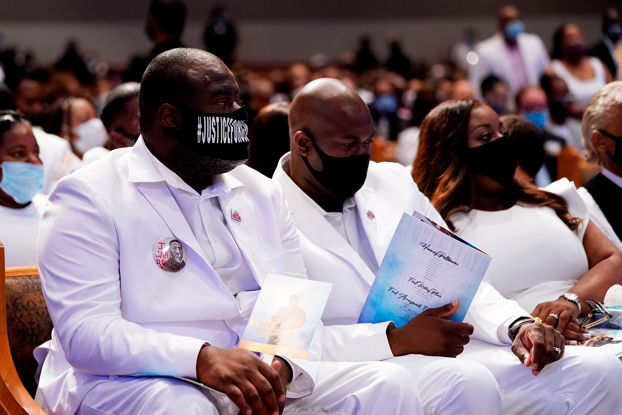 Rodney Floyd (L), and Philonise Floyd (C) brothers of George Floyd, attend their brother's funeral service on June 9, 2020, at The Fountain of Praise church in Houston, Texas.