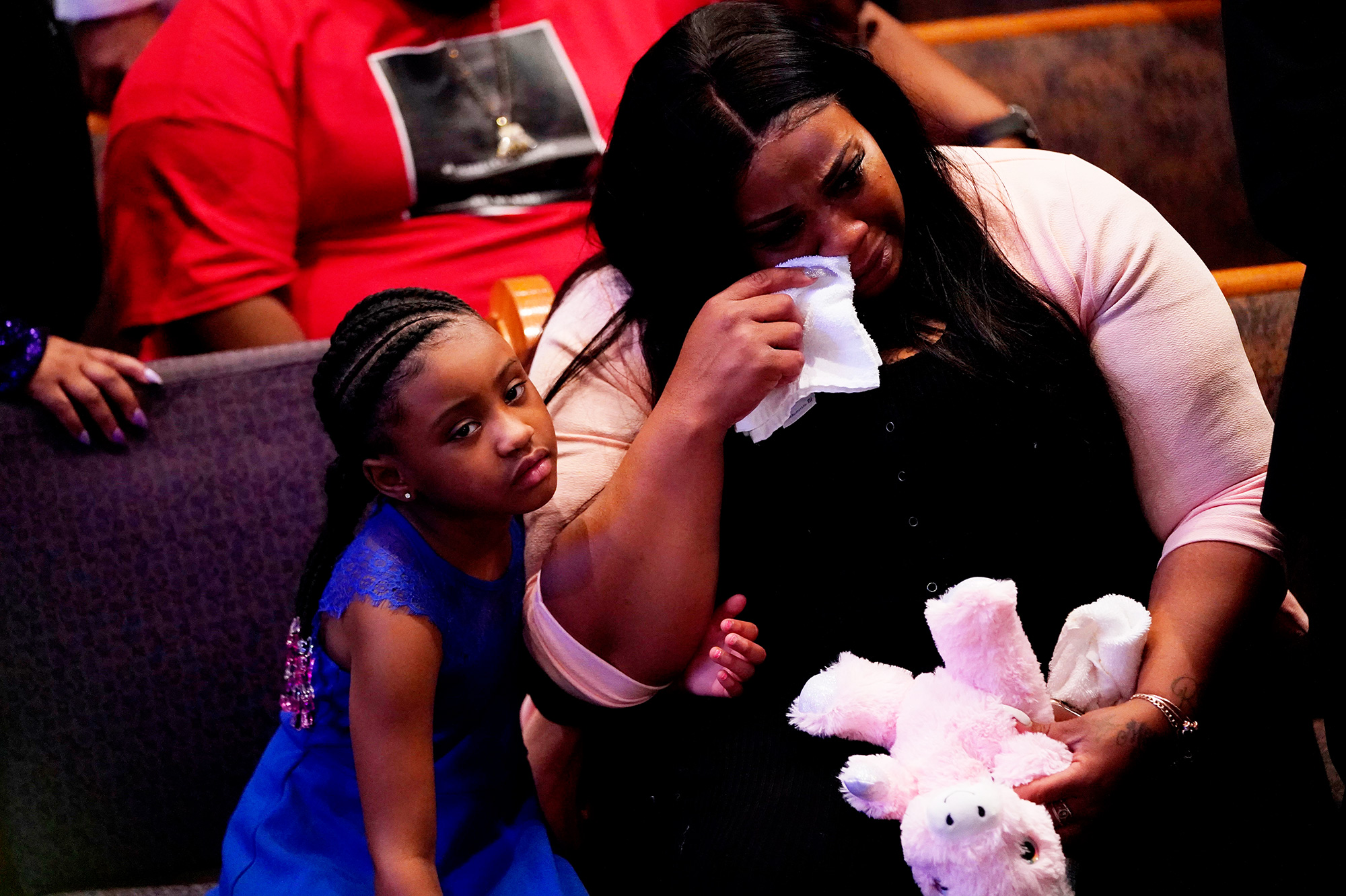 Roxie Washington holds Gianna Floyd, the daughter of George Floyd as they attend the funeral service for George Floyd at The Fountain of Praise church Tuesday, June 9, 2020, in Houston