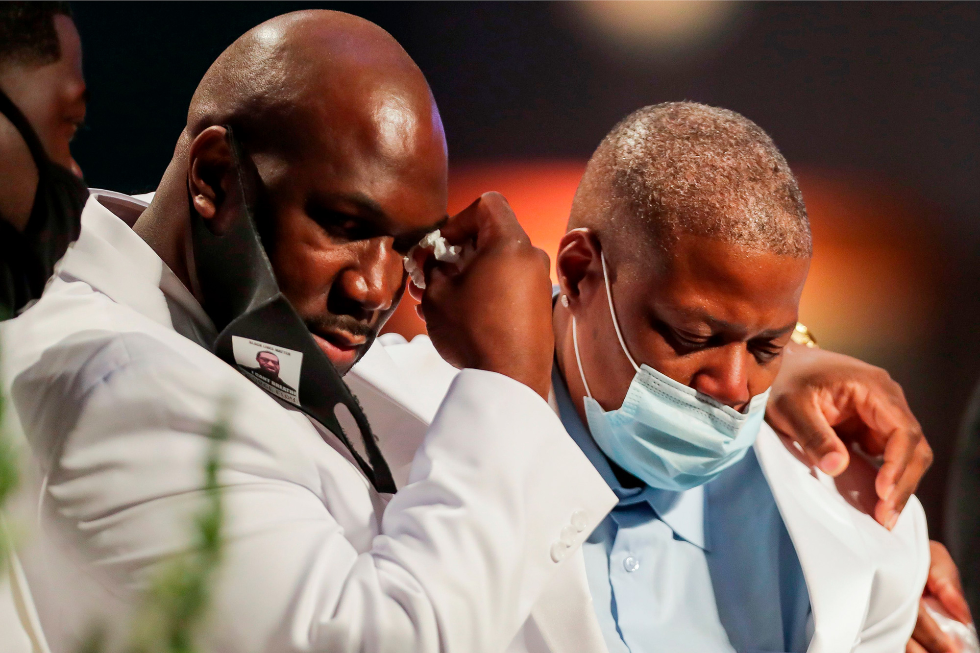 Family members grieve as they speak during the funeral for George Floyd on June 9, 2020, at The Fountain of Praise church in Houston