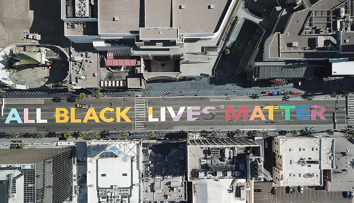 "The words ""All Black Lives Matter"" are seen painted on Hollywood Blvd before the start a solidarity march between the LGBTQ+ and Black Lives Matter communities, June 14, 2020 in Hollywood California"
