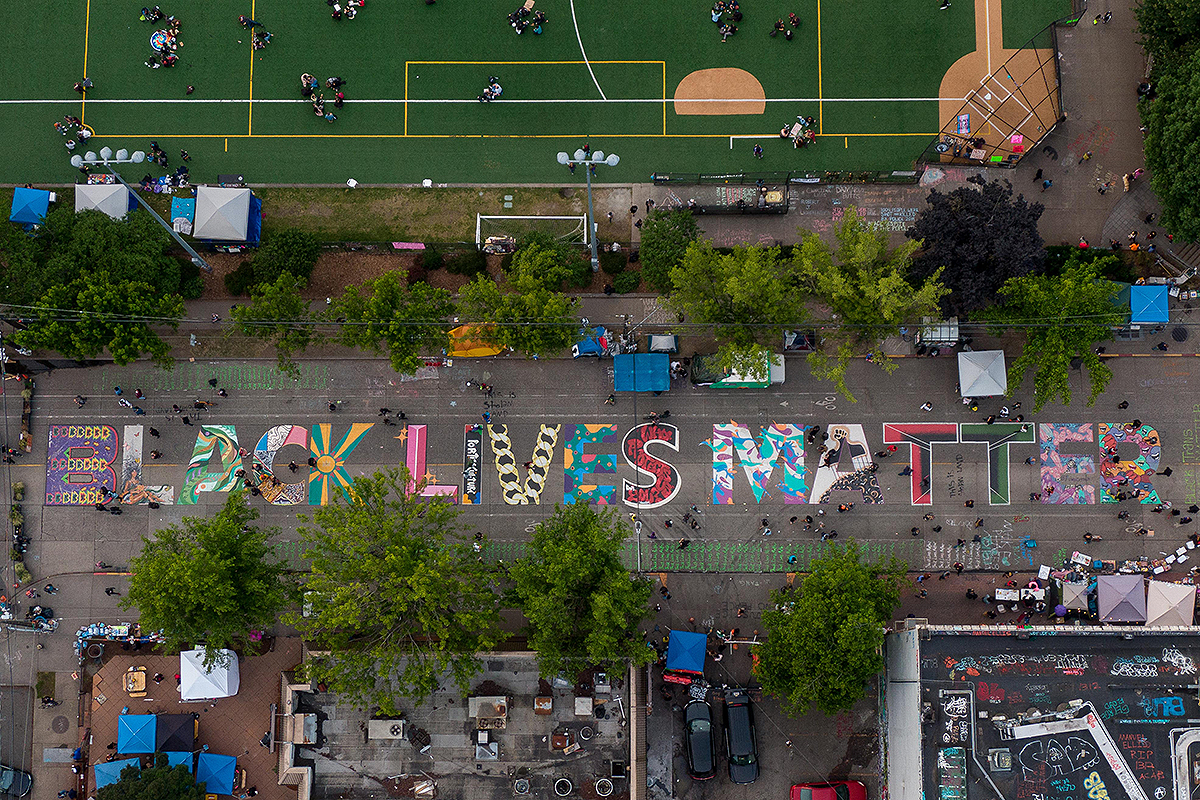 "SEATTLE, WA - JUNE 14: An aerial view of a Black Lives Matter mural on East Pine Street near Cal Anderson Park is seen during ongoing Black Lives Matter events in the so-called ""CHOP,"" an area that protesters have called both the ""Capitol Hill Occupied Protest"" and the ""Capitol Hill Organized Protest, on June 14, 2020 in Seattle, Washington. Black Lives Matter protesters have continued demonstrating in what was first referred to as the Capitol Hill Autonomous Zone, which encompasses several blocks around the Seattle Police Departments vacated East Precinct. ("