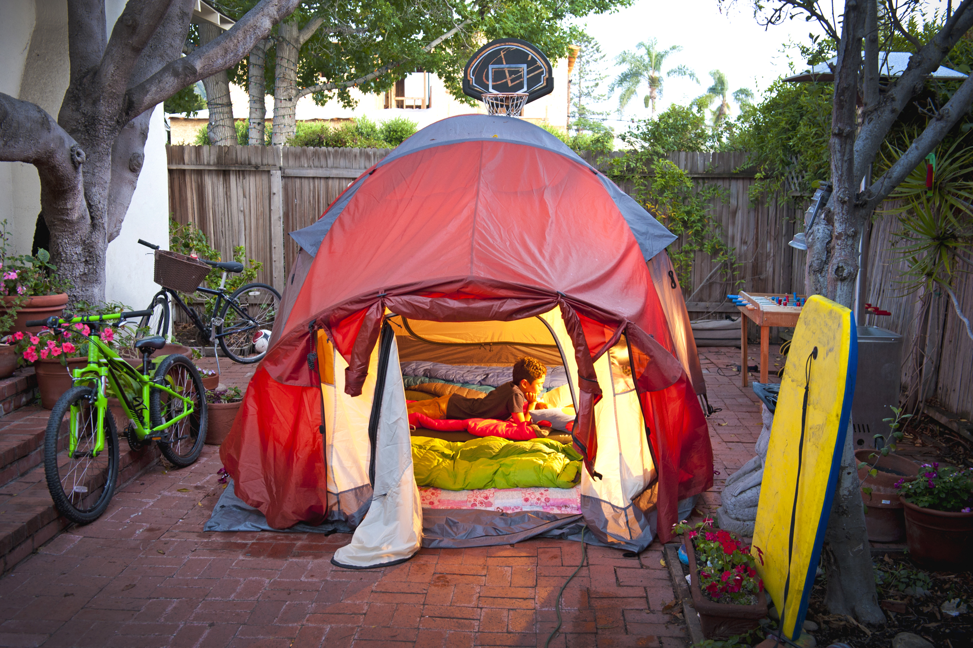 tent in side yard of house